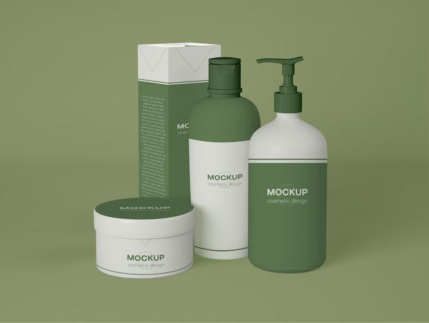 Conjunto de frasco cosmético e frasco de creme com maquete de caixa de embalagem