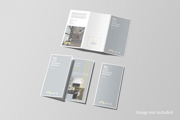 Conjunto de maquete de brochura com três dobras com vista de alto ângulo