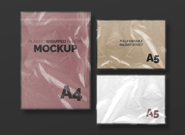 Conjunto de maquete de papéis embrulhados de plástico
