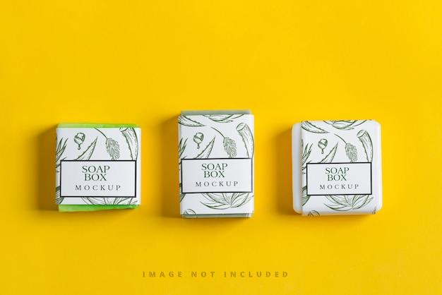 Conjunto de sabonetes naturais à base de plantas feitos à mão com maquete de papel