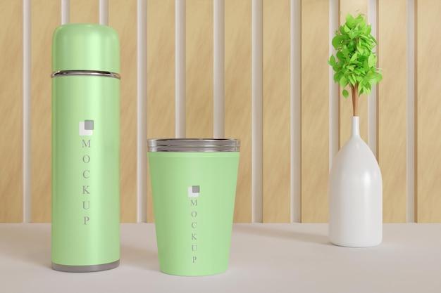 Copo e maquete de copo de bebida com vaso de planta