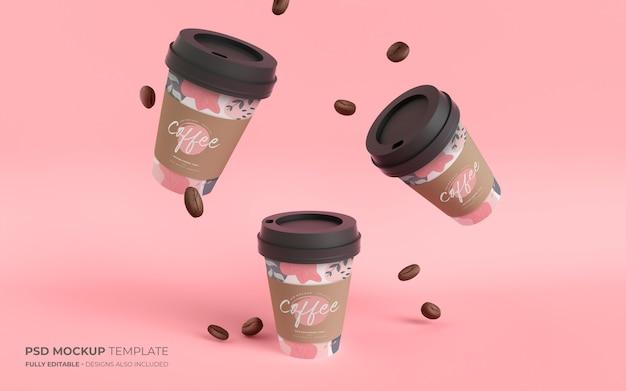 Copos de café e feijão de papel em maquete de gravidade
