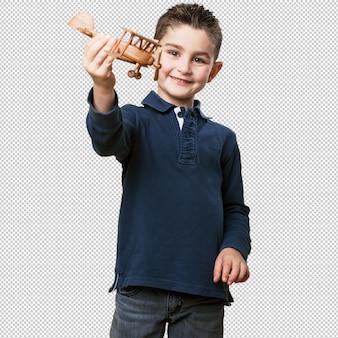 Criança brincando com um biplano