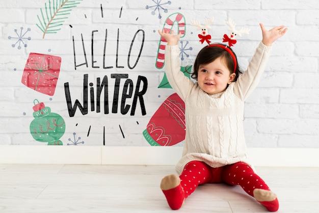Criança feliz com bandana de rena