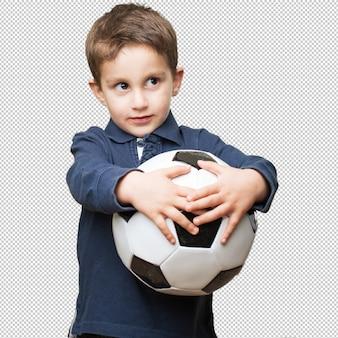 Criança, segurando, um, bola futebol