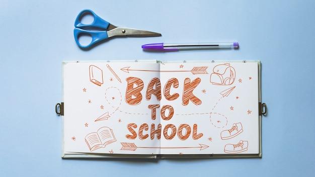 De volta à escola maquete com livro aberto