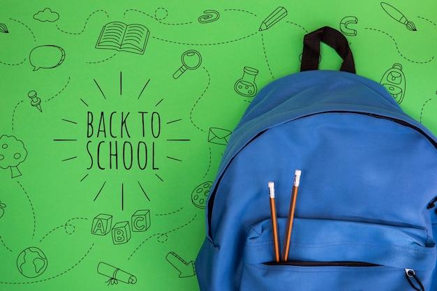 De volta à escola, mochila com material de estudante