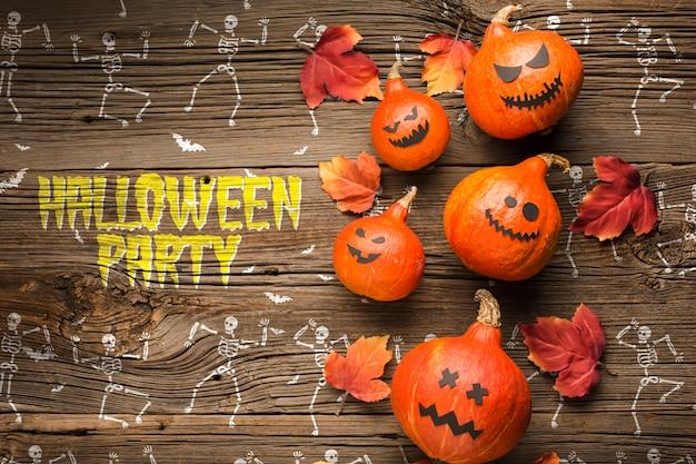 Decoração de abóboras de halloween e desenho de esqueleto
