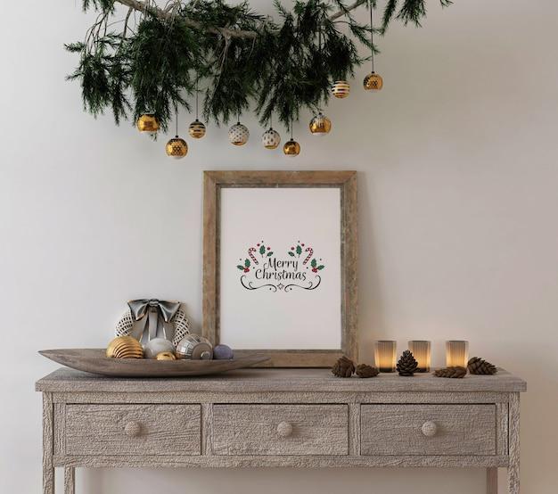 Decoração de conceito de natal com moldura de pôster rústico de maquete na mesa de console