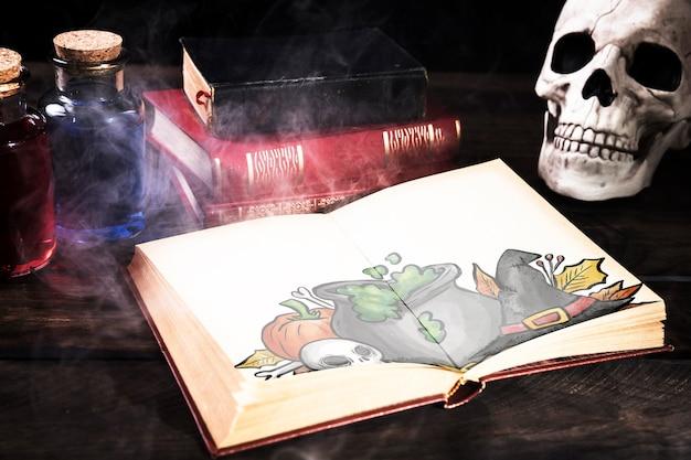 Decoração de mesa de halloween com livro aberto e névoa
