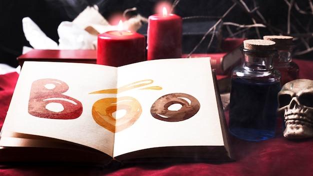 Decoração de mesa de halloween e livro com boo! texto