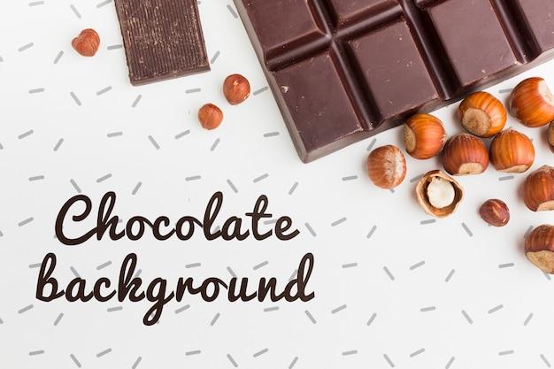 Delicioso chocolate e castanhas no modelo de fundo branco