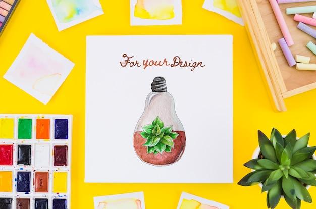 Desenho de folha de papel com ferramentas de desenho