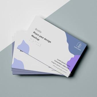 Desenho plano de designs de cartão de visita com escrita em braille