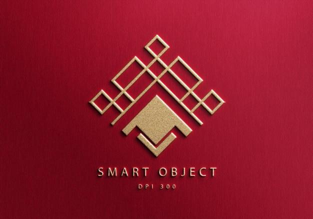 Design de maquete de logotipo elegante em plano de fundo texturizado vermelho