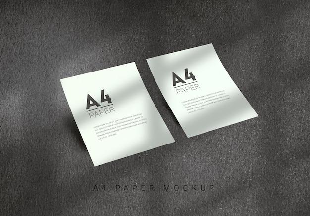 Design de maquete de papel a4 com fundo cinza