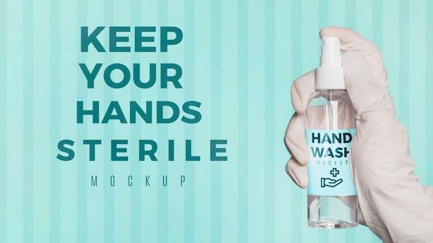 Desinfetante de exploração de mão close-up