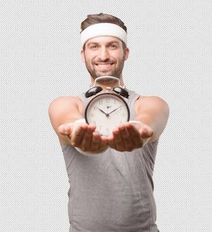 Desportivo homem com despertador