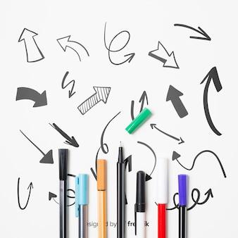 Disposição plana com canetas coloridas