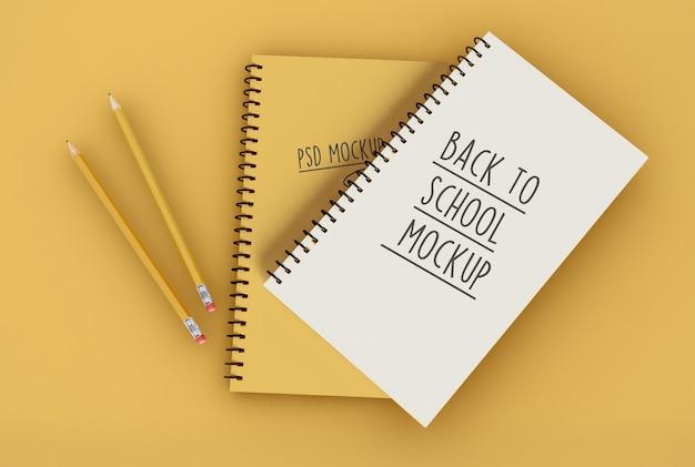 Dois blocos de notas em espiral com modelo de maquete de lápis