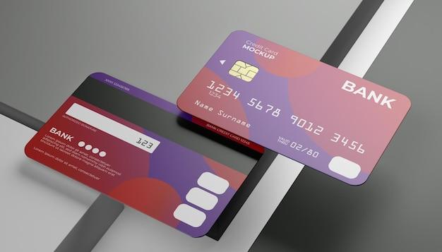 Dois cartões de crédito simulados com sombra clara e plano de fundo do palco do cubo