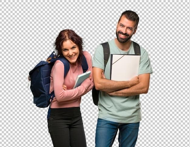 Dois, estudantes, com, mochilas, e, livros, mantendo, a, braços cruzaram, enquanto, sorrindo
