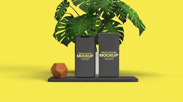 Dois smartphones com maquete de planta