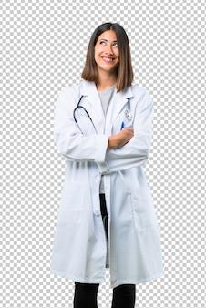 Doutor, mulher, com, estetoscópio, levantar, e, olhar, enquanto, sorrindo
