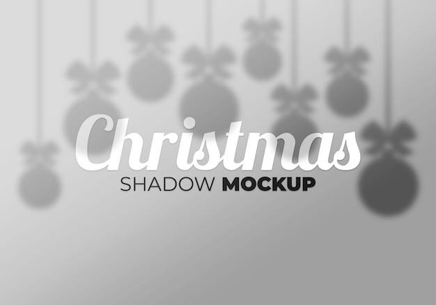 Efeito de sobreposição cinza da maquete de sombras transparentes de natal com bola