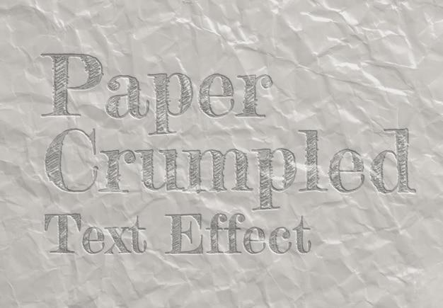 Efeito de texto em relevo na textura da folha de papel amassada mockup