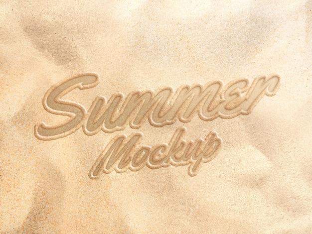 Escrever texto de areia na maquete de efeito de verão de praia