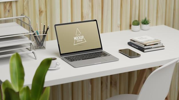 Espaço de trabalho de renderização 3d com laptop