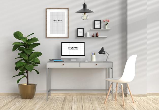 Espaço de trabalho no interior da casa com computador e maquete de quadros
