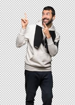 Esporte homem apontando com o dedo indicador e olhando para cima