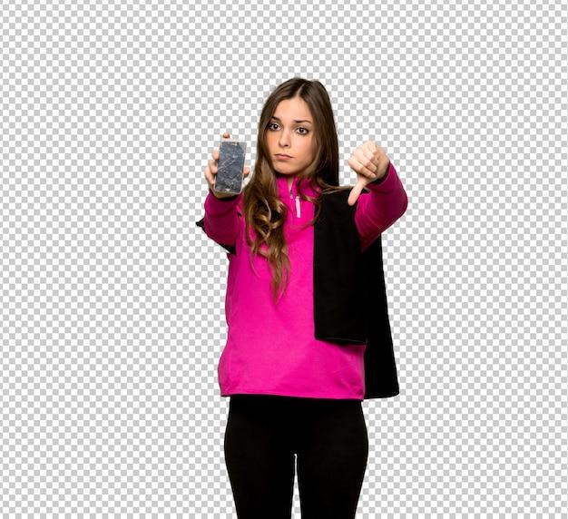Esporte jovem mulher com incomodado segurando smartphone quebrado