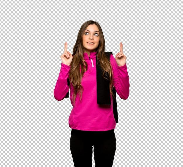 Esporte jovem mulher com os dedos cruzando e desejando o melhor