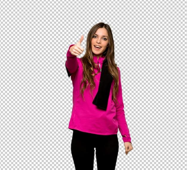 Esporte jovem mulher dando um polegar para cima gesto porque algo bom aconteceu