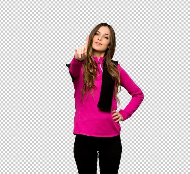 Esporte jovem mulher mostrando e levantando um dedo