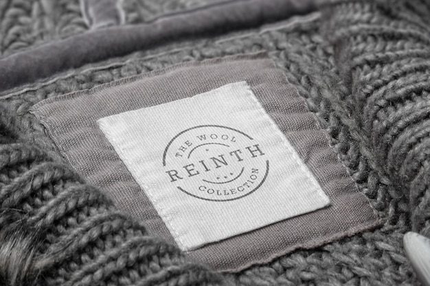 Etiqueta de suéter de maquete de logotipo