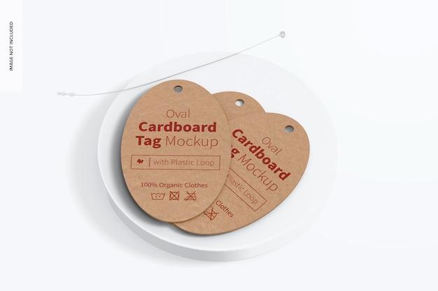 Etiquetas de papelão ovais com modelo de loop de plástico, vista superior