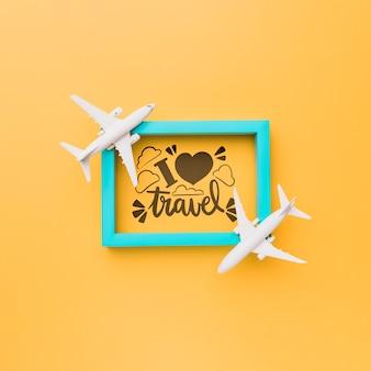 Eu amo viajar letras com moldura e aviões