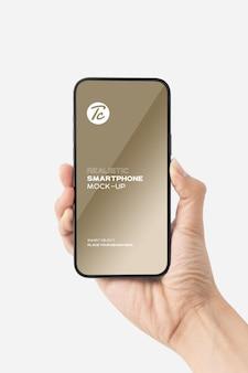 Feche a mão segurando a maquete de smartphone para seu projeto