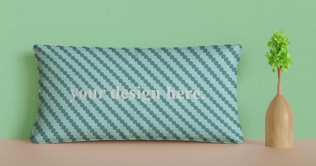 Feche a maquete de travesseiro retangular com vaso de planta