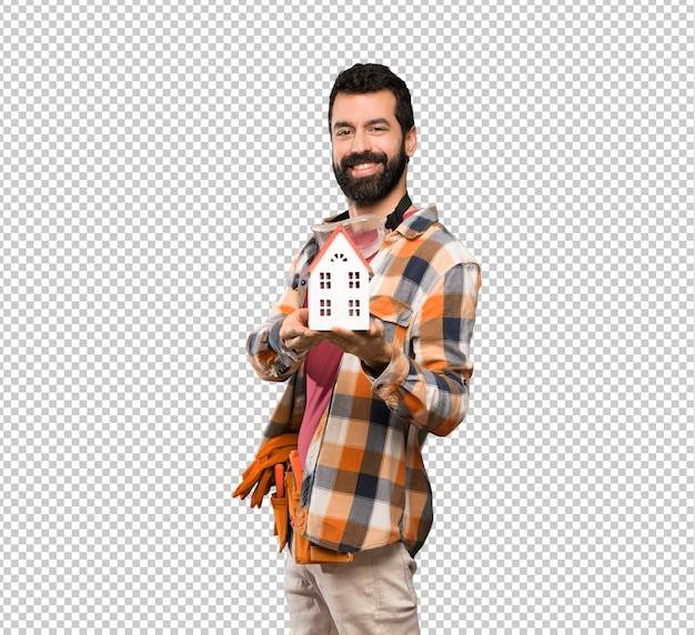 Feliz, artesãos, homem, segurando, um, pequeno, casa