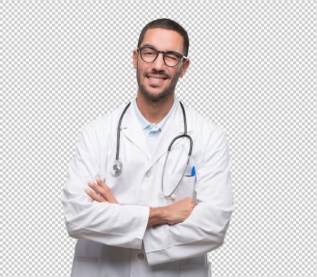 Feliz jovem médico piscando um olho