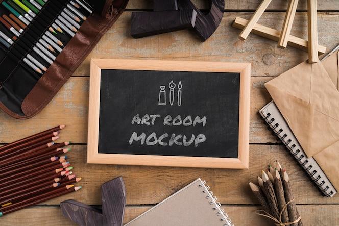 Ferramentas de pintura do artista de vista superior e moldura