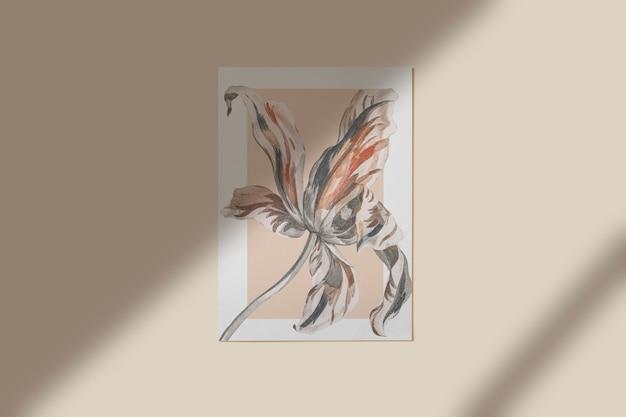 Flor pintada em um quadro na parede
