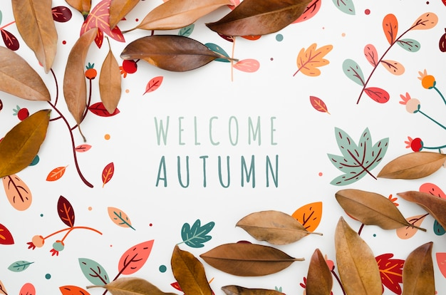 Folhas coloridas emoldurando letras de outono bem-vindo