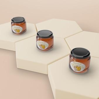 Forma de favo de mel com potes de mel