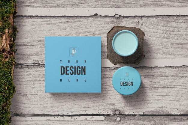 Frasco cosmético azul e maquete de caixa